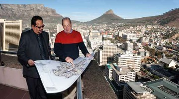 John Rabie (right) of Signatura and property owner Shaun Rai view plans of the Radisson Hotel and Residence, Cape Town from one of the penthouse balconies.