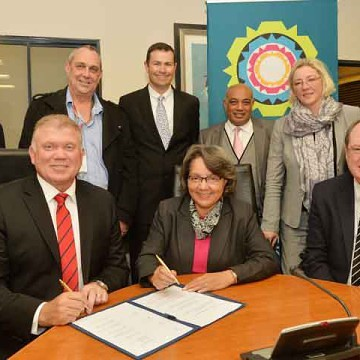 Neil Hayes – Managing Director of AECI's property portfolio; Dr Ivan Bromfield – the City's Executive Director for Human Settlements; Mark Kathan – AECI Chief Financial Officer; Achmat Ebrahim – City Manager (City of Cape Town); and Councillor Benedicta van Minnen – the City's Mayoral Committee Member for Human Settlements Front, from left: Mark Dytor – AECI Chief Executive; Patricia de Lille – the City's Executive Mayor; and Alderman Ian Neilson – the City's Executive Deputy Mayor