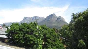 The scenic view of the Back Table and Devil's Peak from the balcony of a Rosebank home priced at R3,9 million, on the market through Knight Frank Residential SA.