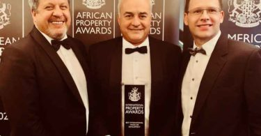 Accepting the award is (l to r) Werner van Rhyn - a director at the Waterfall Investment Company, Willie Vos - CEO of Waterfall Management Company and Phillip Badenhorst - CFO of Waterfall Management Company.