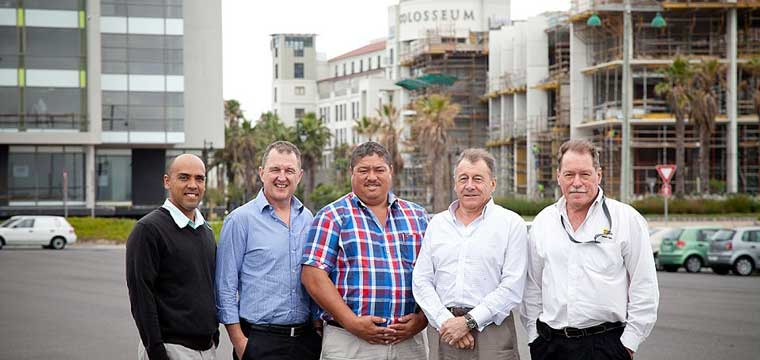 Rabie Property Group, joint developers of the R450million Bridge Park development at Century City with Growthpoint Properties, handed over the site to Murray & Roberts Western Cape this week. At the handover were from left Rabie Project manager Raynard Haupt, Rabie Group Director Colin Anderson, Murray & Roberts Western Cape Managing Director Dave Heron, Murray & Roberts Commercial Director Richard Mann & Murray & Roberts Contracts Manager Granvil Jacobs.
