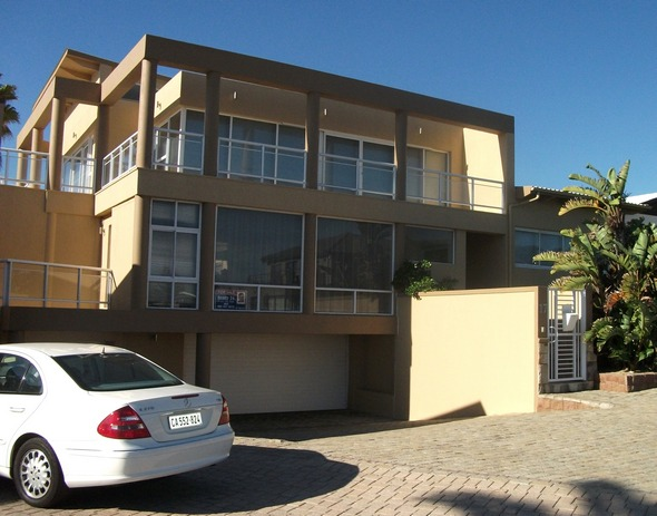 Sited at van Riebeeckstrand is this ultra-modern and luxurious home now for sale at R6,4 million.  This home has four bedrooms, three bathrooms, three reception areas, a wine cellar and garaging for three cars.  It also has a very attractive swimming pool.