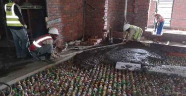 Upcycled plastic beverage bottles, also known as ecobricks, are being used as void formers in the concrete slabs in the central toilet areas on each floor of The Ridge. Photo credit: Gareth Griffiths©.